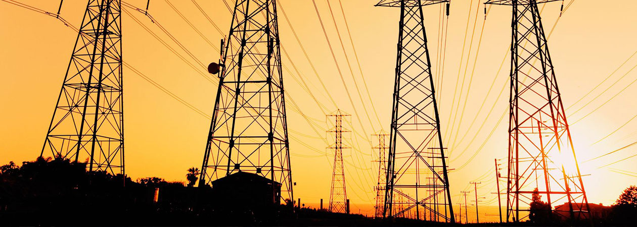 electricity pylons in the morning sun